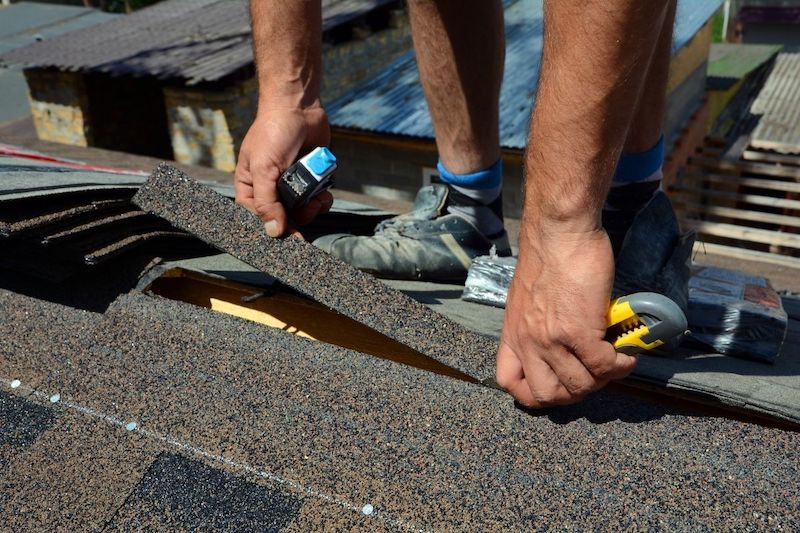 roofer undertaking rood restoration project in loganlead qld